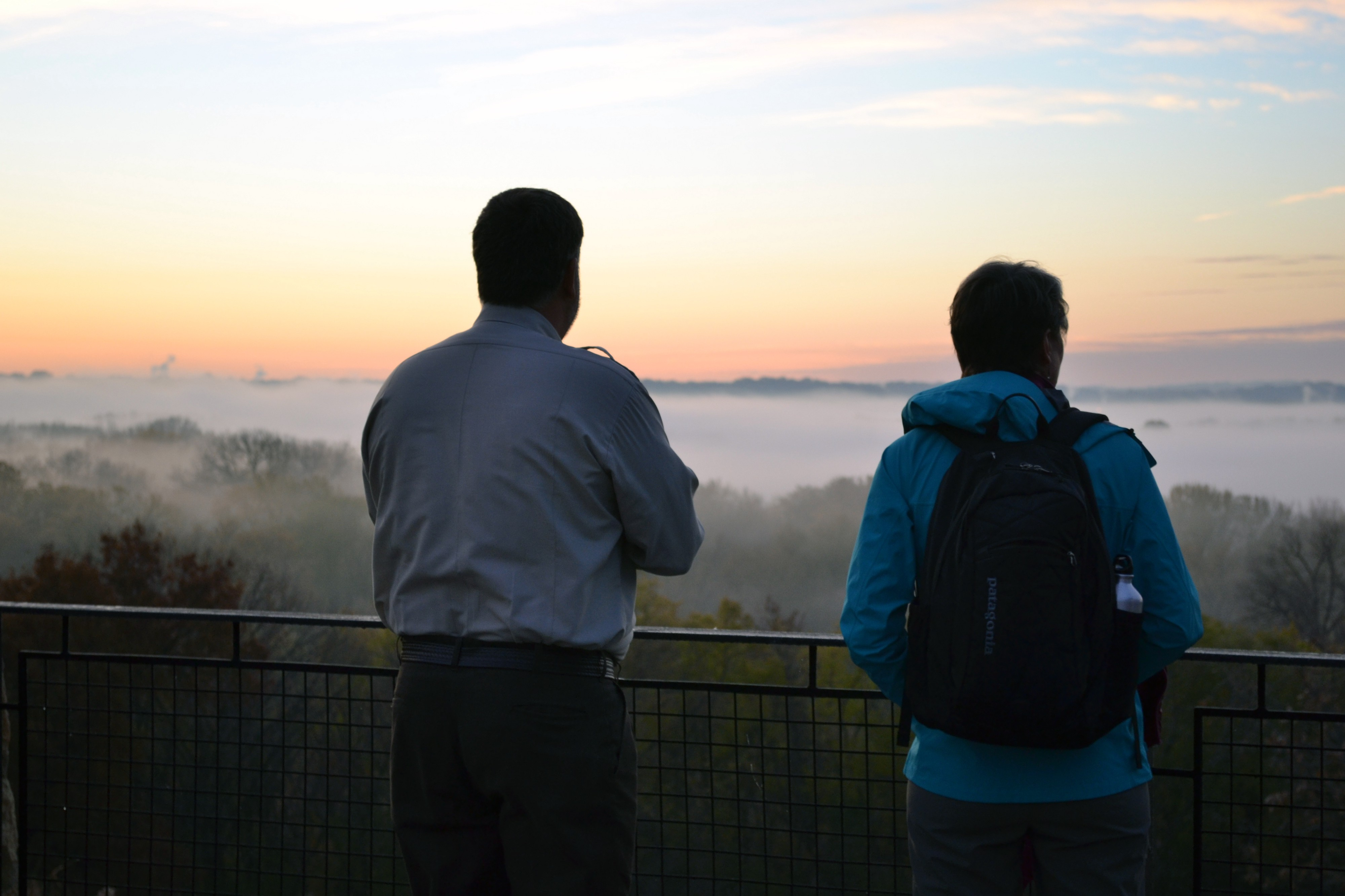 Refuge Manager Tim Bodeen takes in the sunrise with Secretary Sally Jewell at Minnesota Valley National Wildlife Refuge