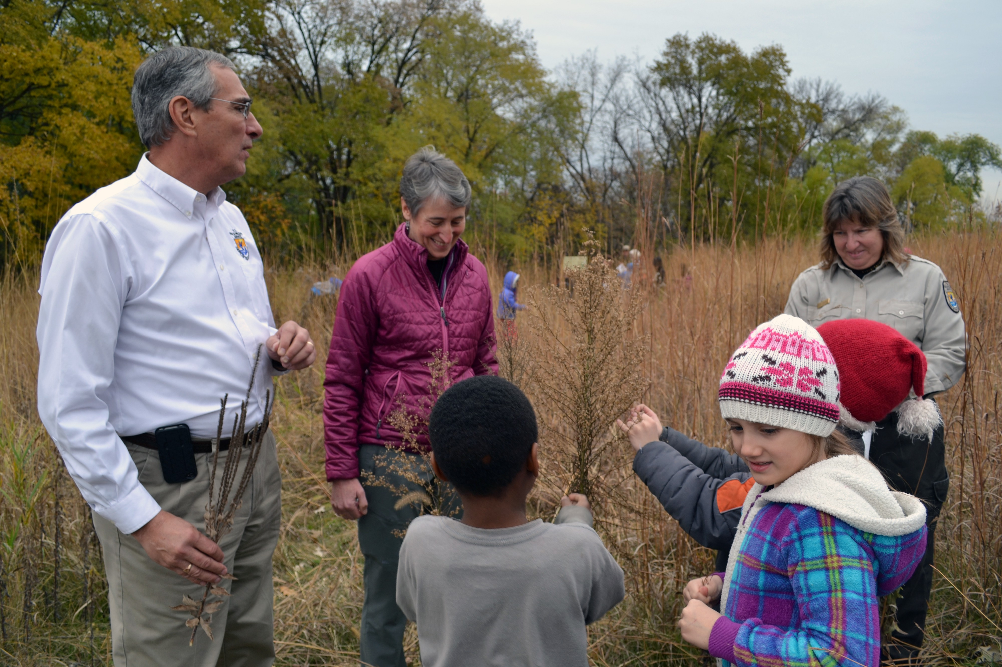 Secretary Sally Jewell and Regional Director Tom Melius help Minneapolis second graders collect native prairie seeds during her visit to Minnesota Valley National Wildlife Refuge