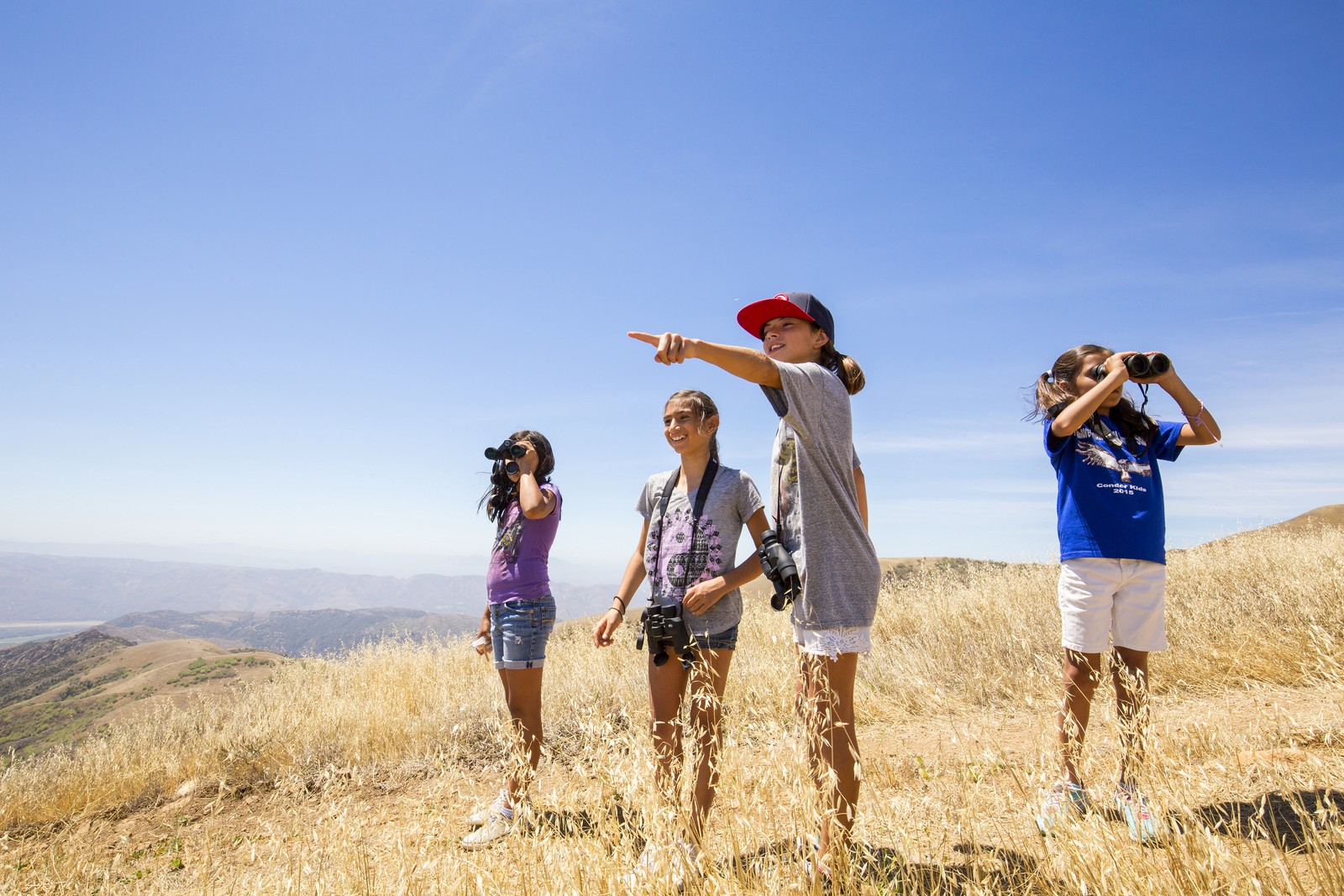 Students from Fillmore Elementary School learn how to use binoculars and search for endangered California condors on Hopper Mountain National Wildlife Refuge. This refuge is directly behind and above the school.