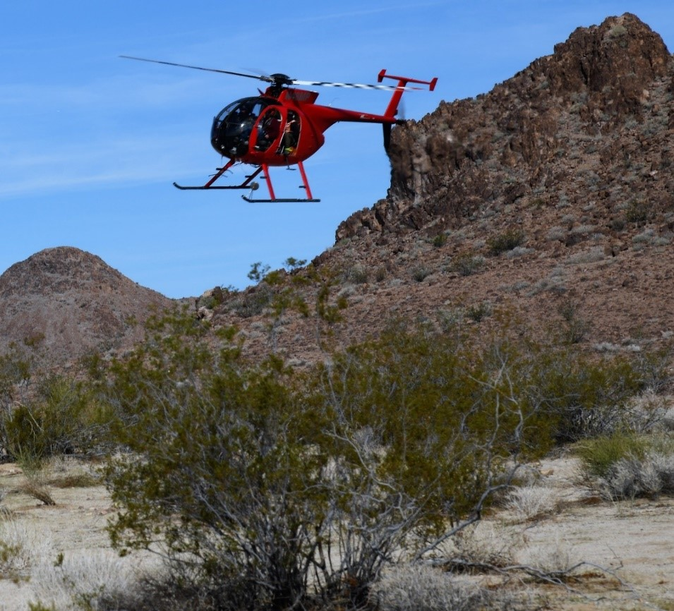 California Department of Fish and Wildlife's contracted Helicopter Bighorn Capture Crew in a 2018 flight at the Marble Mountains of the California Desert.