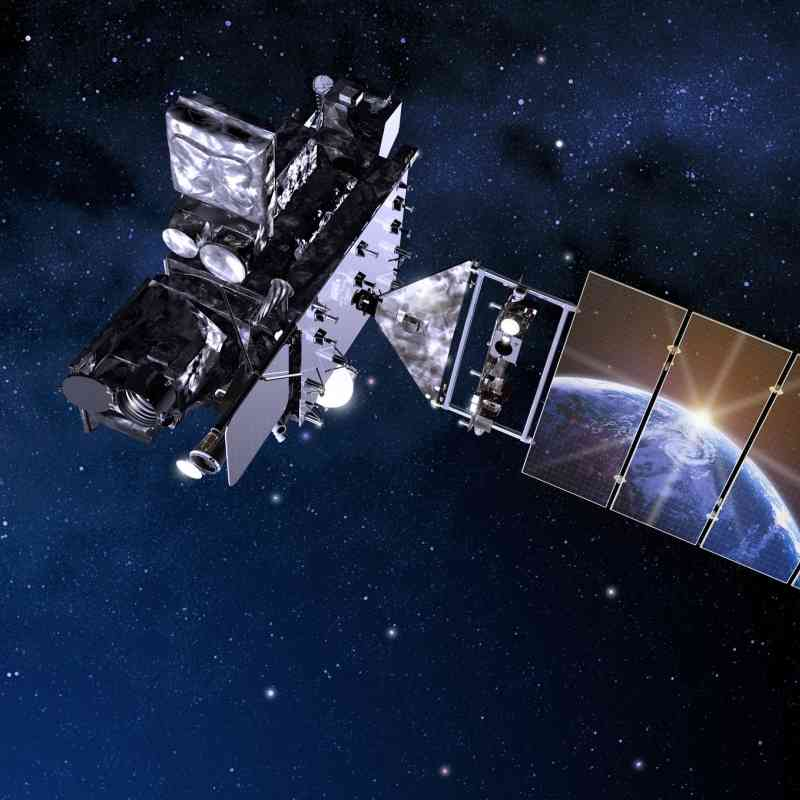 Artist's rendition of GOES R satellite with Earth reflecting off solar panel.
